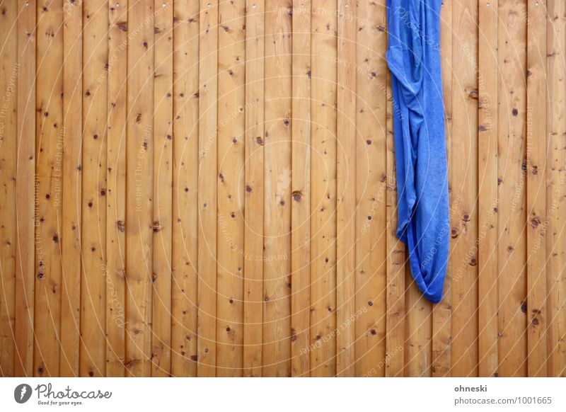 hang out Facade Garden Fence Sheet Wooden fence Wooden board Blue Laundry Washing Colour photo Exterior shot Abstract Pattern Structures and shapes