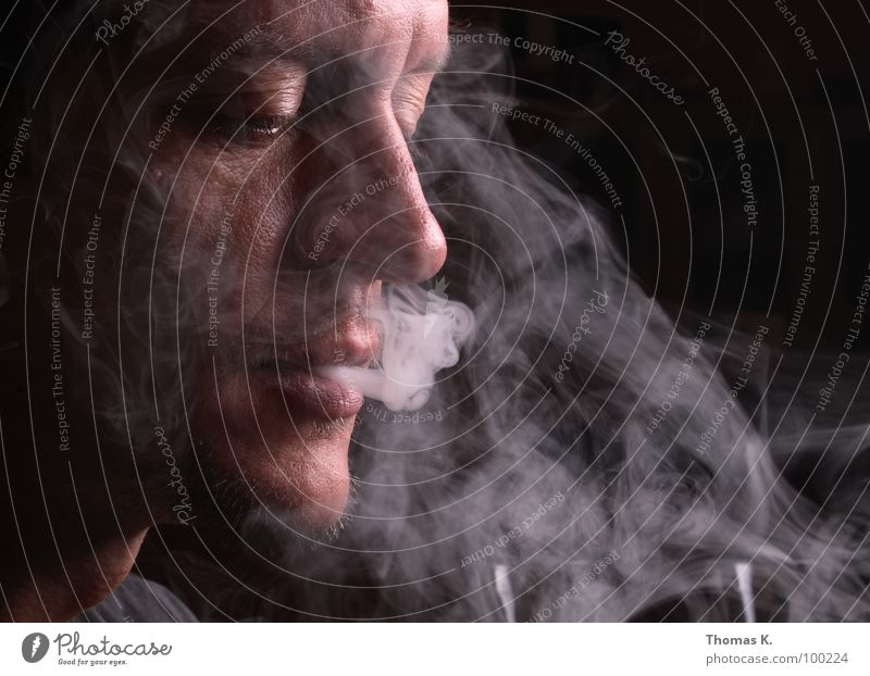 smoke Portrait photograph Cigarette Lighter Hand Illness Bans Ignite Blaze Tobacco products Pulmonary disease Black Eyeglasses Lung Gullet Larynx Smoking Cancer