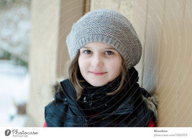 It's cold outside Winter Snow Winter vacation Human being Feminine Girl Infancy 1 8 - 13 years Child Pelt Observe Think Looking Stand Friendliness Fresh Healthy