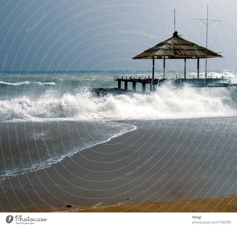 jetty with sun canopy on the beach in stormy seas Lake Ocean Waves White crest Foam Wet Flow Beach Footbridge Roof Gale Turkey Surf Brown Walking Passion