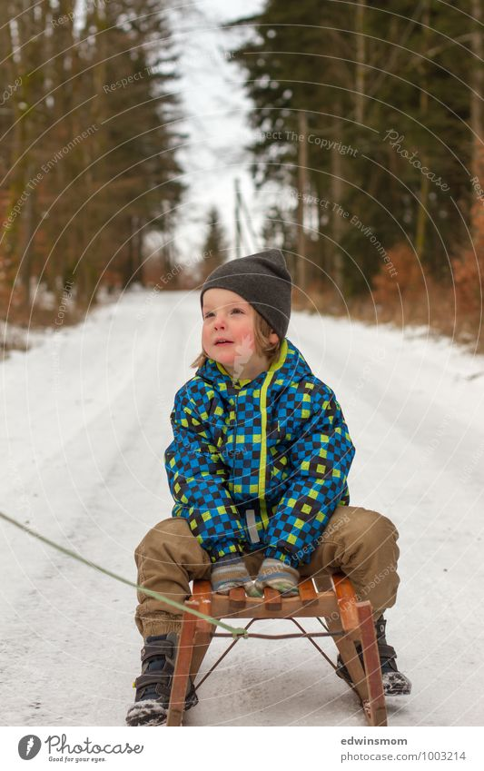 Human being Child Blue White Joy Winter Cold Face Snow Boy (child) Brown Sit Infancy Wait Footwear Trip