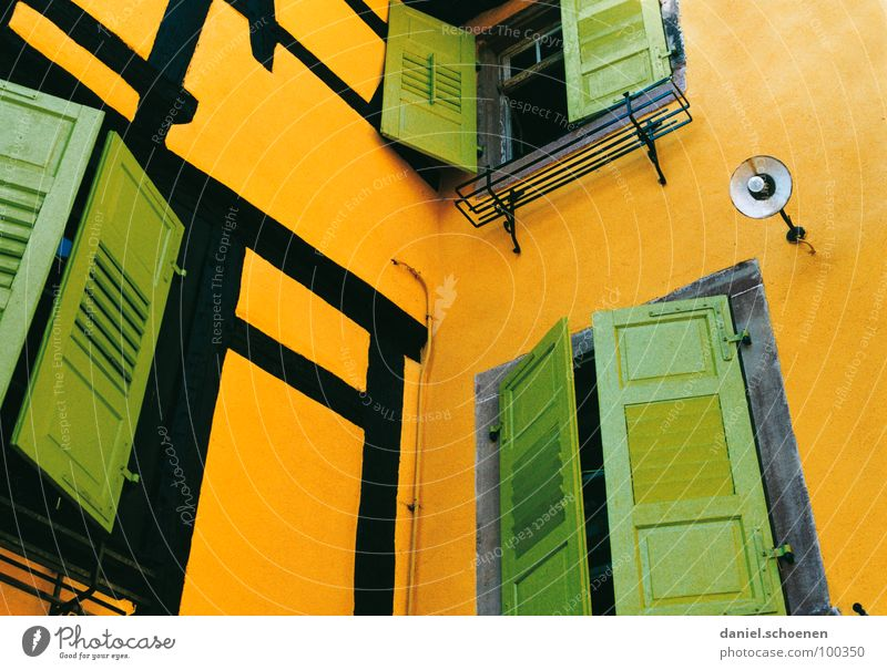 yellow-green Yellow Green Pea green Multicoloured Window Shutter Lamp Half-timbered facade France Alsace Facade Close Undo Detail Orange Colour