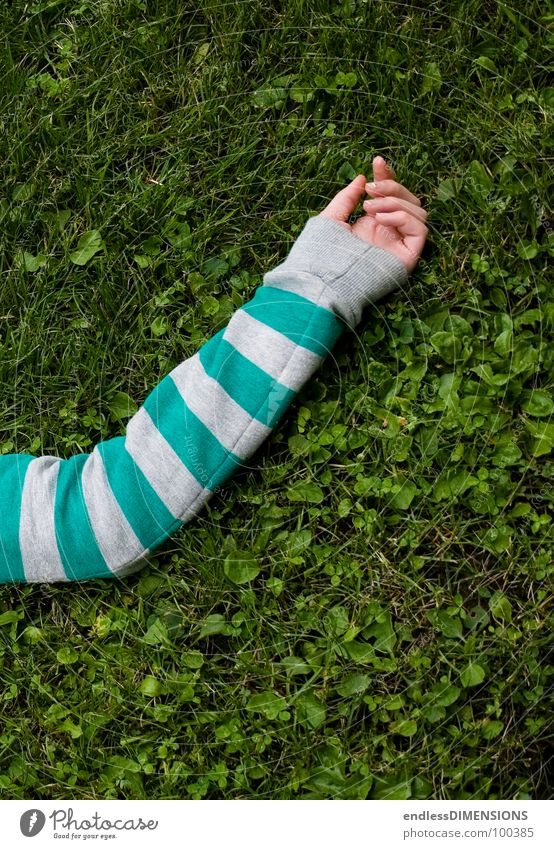 The arm Hand Meadow Grass Sweater Relaxation Green Turquoise Gray Clothing Summer Arm Lie Limbs Parts of body Striped sweater Break Bird's-eye view 1