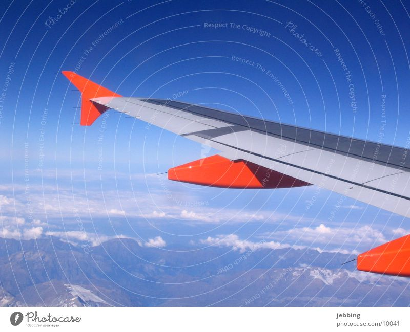 flapping Airplane Vantage point Clouds Sky Covers (Construction) Transport Wing Flying Far-off places Mountain Alps Jet