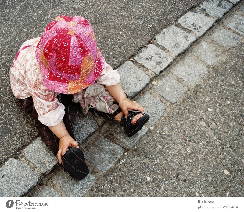 Child Girl Street Footwear Pink Floor covering Hat Boredom Toddler