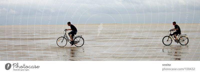Bicycle race in Denmark's Wadden Sea Mud flats Ocean Rømø Beach Coast wad