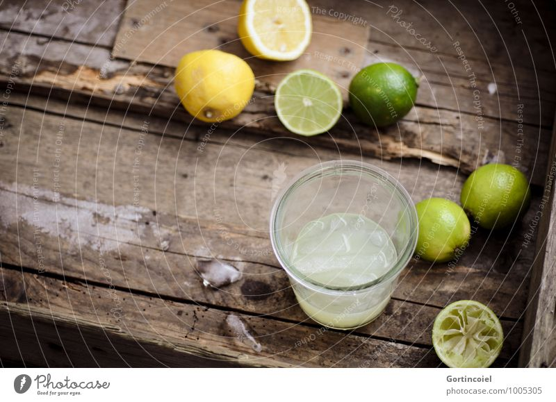 citron Food Beverage Cold drink Lemonade Juice Longdrink Cocktail Glass Fresh Delicious Brown Yellow Green Lime Ice cube Citrus fruits Colour photo