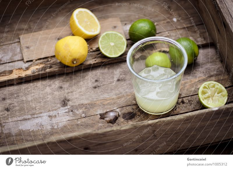 citrus juice Food Beverage Cold drink Lemonade Juice Longdrink Cocktail Glass Fresh Delicious Brown Yellow Green Lime Ice cube Citrus fruits Colour photo