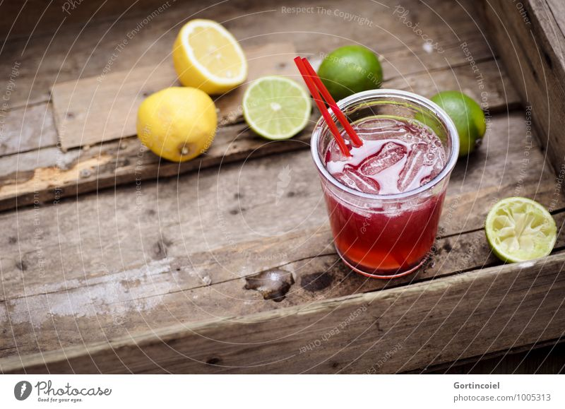 cocktail Food Beverage Cold drink Lemonade Juice Longdrink Cocktail Glass Fresh Delicious Brown Yellow Green Lime Ice cube Citrus fruits Colour photo