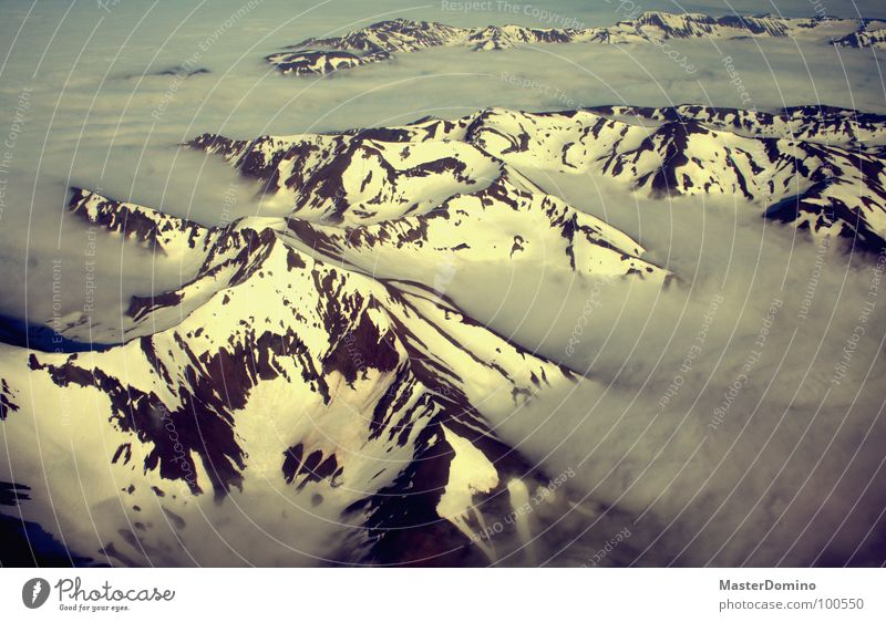 cloud fjord Akureyri Iceland Clouds Bad weather Cloud cover Stick out Permeate Airplane Bird's-eye view Flying Sunlight Light Glacier Winter Aerial photograph