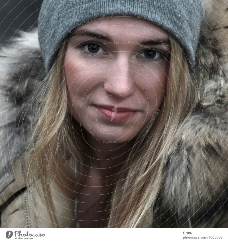 . Feminine Young woman Youth (Young adults) 1 Human being Coat Cap Blonde Long-haired Observe Smiling Looking Wait Beautiful Contentment Cool (slang) Willpower