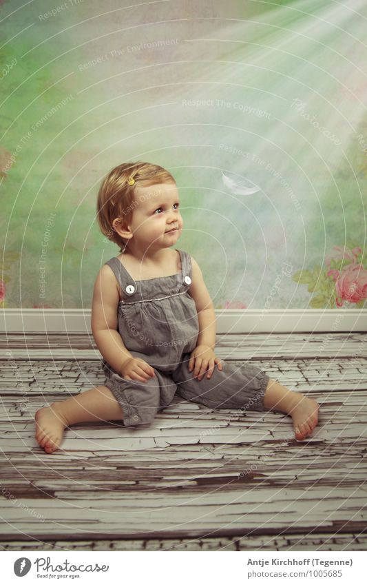 little wonder Child Toddler Girl 1 Human being 1 - 3 years Pants Observe Discover Sit Playing Blonde Brash Cute Sweet Green Happy Colour photo Multicoloured