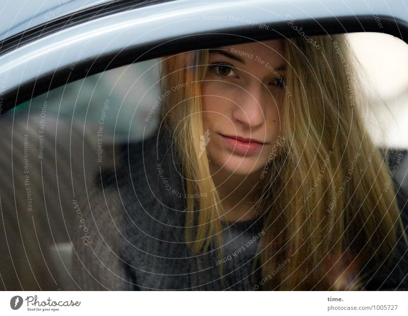 . Masculine Young woman Youth (Young adults) 1 Human being Car Sweater Blonde Long-haired Observe Looking Sit Wait Beautiful Feminine Contentment Self-confident