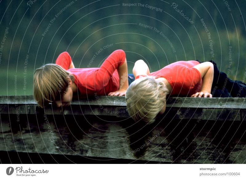 Child Nature Youth (Young adults) Water Red Wood 2 Lie Bridge Search Curiosity Observe River Sporting event Brook Competition