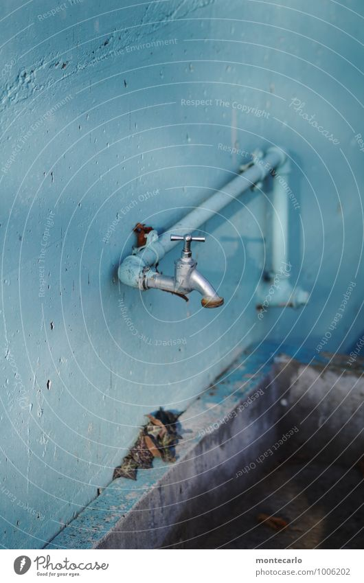 Homemade a photo. Tap Conduit Basin Concrete Metal Old Thin Authentic Simple Cold Long Near Wet Original Round Gloomy Dry Blue Gray Colour photo Multicoloured