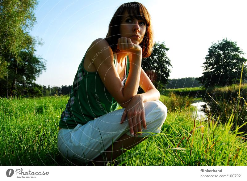 Scared? Meadow Green Grass Blade of grass Woman Summer Fear Exterior shot Tree Brook Lower Saxony Mistrust Thin White Pants River Blue Sky Sun Eyes