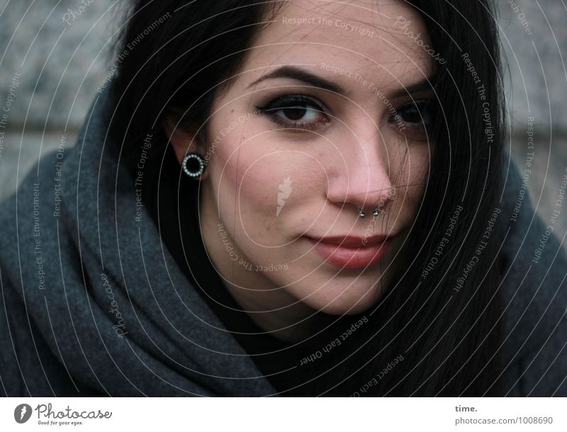 Ana Feminine Young woman Youth (Young adults) 1 Human being Wall (barrier) Wall (building) Coat Jewellery Piercing Earring Black-haired Long-haired Observe