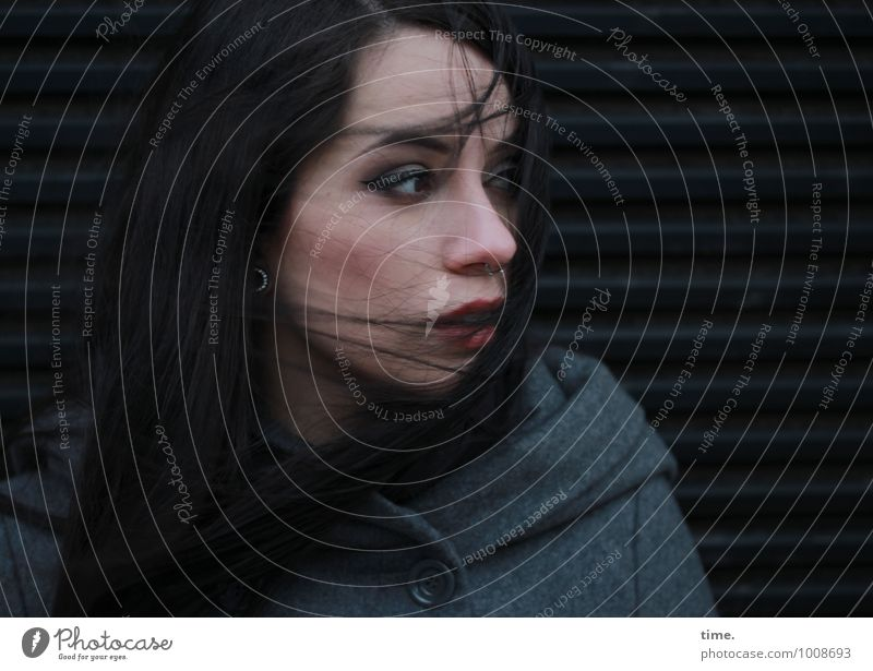 . Feminine Young woman Youth (Young adults) 1 Human being Coat Piercing Black-haired Long-haired Observe Think Looking Wait Beautiful Watchfulness Authentic