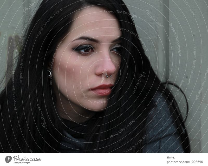 Ana Feminine Young woman Youth (Young adults) 1 Human being Wall (barrier) Wall (building) Coat Piercing Black-haired Long-haired Observe Think Looking Sadness