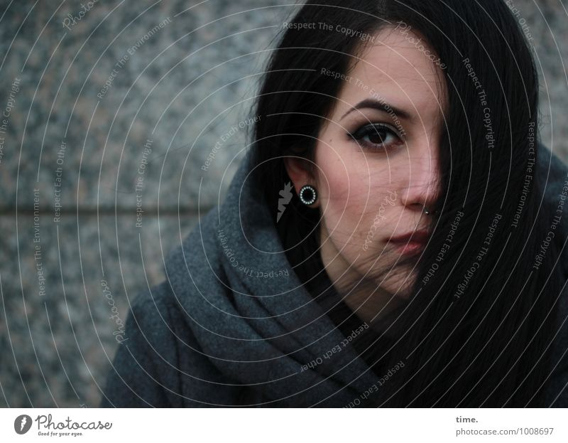. Feminine Young woman Youth (Young adults) 1 Human being Wall (barrier) Wall (building) Coat Piercing Earring Black-haired Long-haired Observe Looking
