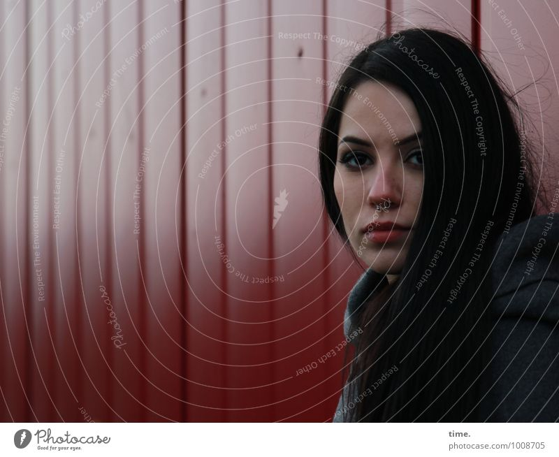 . Feminine Young woman Youth (Young adults) 1 Human being Wall (barrier) Wall (building) Container Coat Piercing Black-haired Long-haired Observe Looking Wait