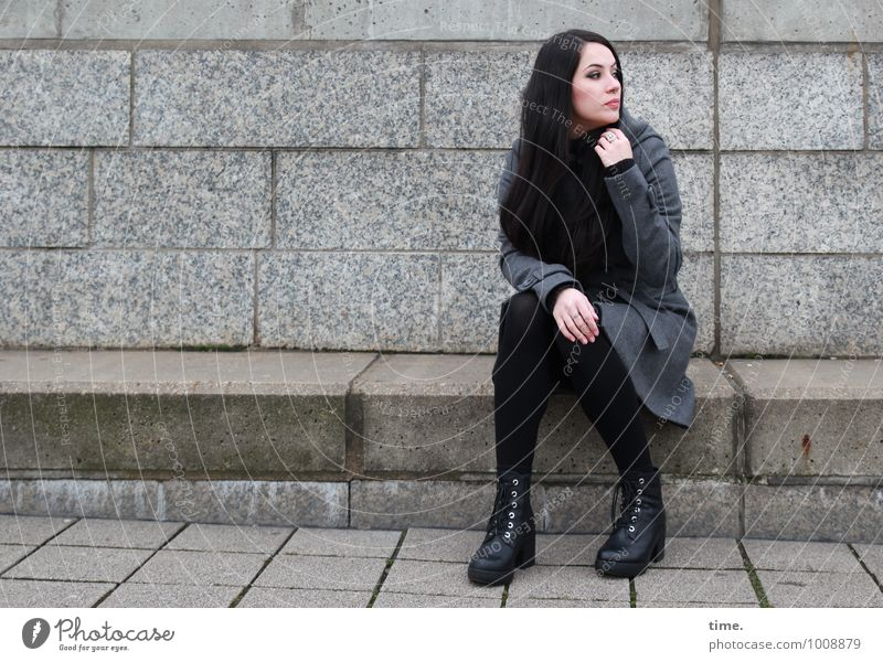 . Feminine Young woman Youth (Young adults) 1 Human being Wall (barrier) Wall (building) Stairs Coat Footwear Black-haired Long-haired Observe Looking Sit Wait