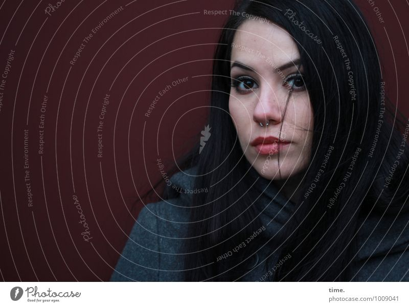 Ana Feminine Young woman Youth (Young adults) 1 Human being Wall (barrier) Wall (building) Coat Piercing Black-haired Long-haired Observe Looking Wait pretty