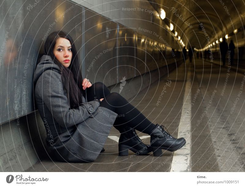 . Feminine Young woman Youth (Young adults) 1 Human being Hamburg Elbtunnel Coat Boots Black-haired Long-haired Observe Looking Sit Wait Dark Beautiful