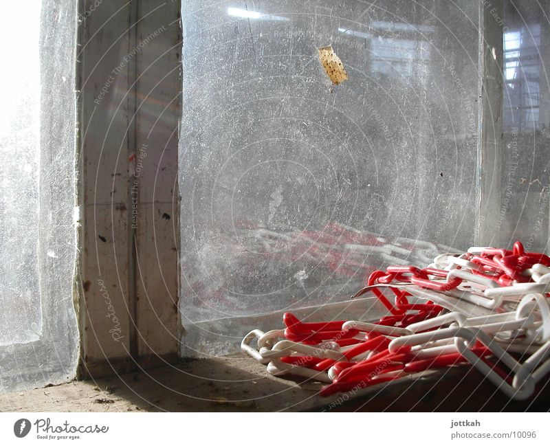 Still life with barrier chain Barrier Red White Window Dirty Industry Glass Window pane