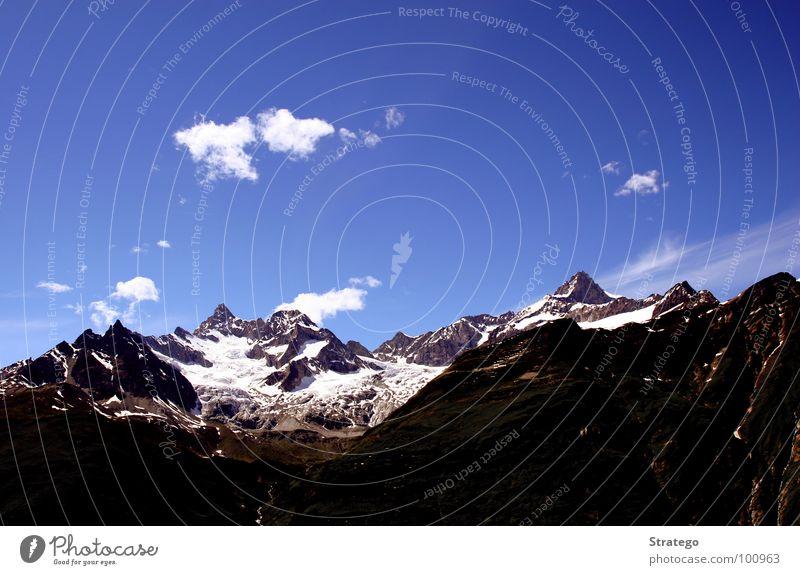 Nature Sky Blue Clouds Far-off places Dark Snow Mountain Stone Lanes & trails Landscape Hiking Horizon Rock Tourism Level