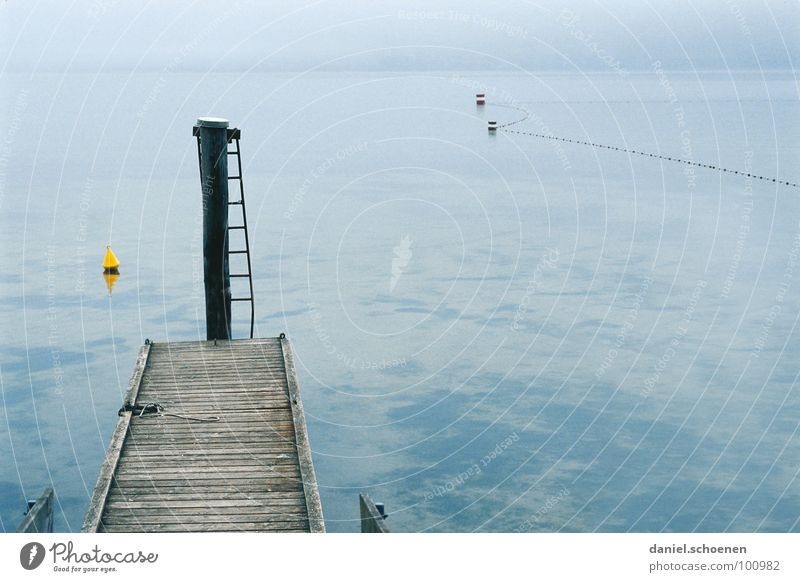 Nothing going on at the lake Lake Autumn Footbridge Fog Calm Horizon Buoy Gray Yellow Background picture Gloomy Grief Distress Blue Ladder Water