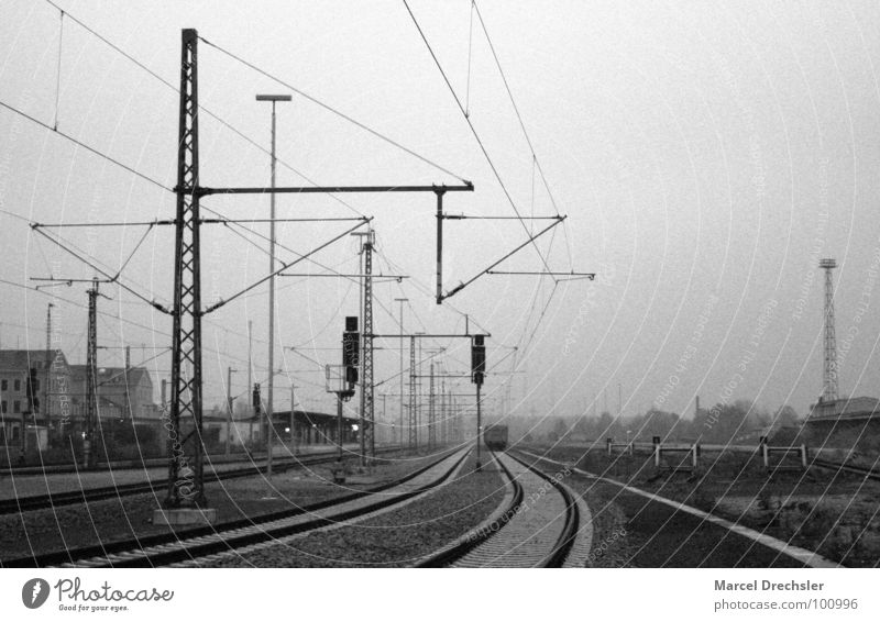 Old Freiberg railway station Railroad tracks Grief Dark Black White Gray Railroad car Electricity Train station Distress Black & white photo Cable Sadness Calm