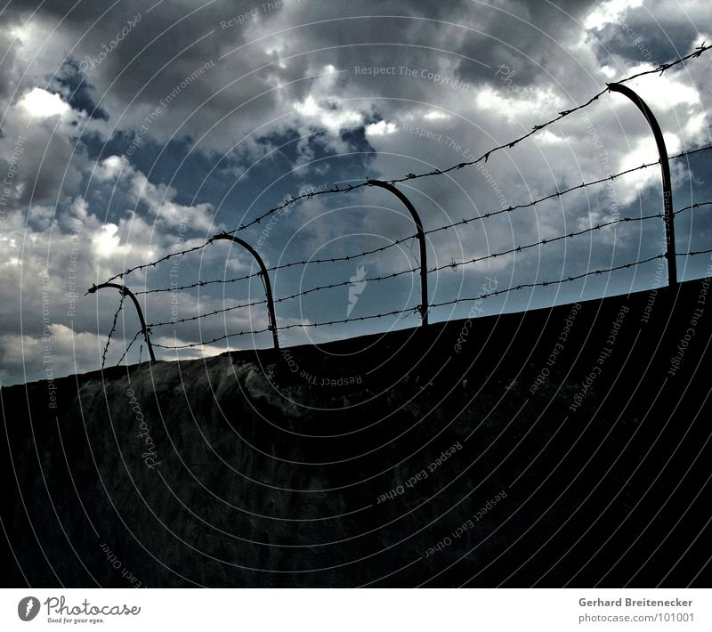 simplicity Wall (barrier) Barbed wire Clouds Thunder Border Confine Loneliness Exit route Captured Grief Distress Sky Thunder and lightning Rain Force Escape