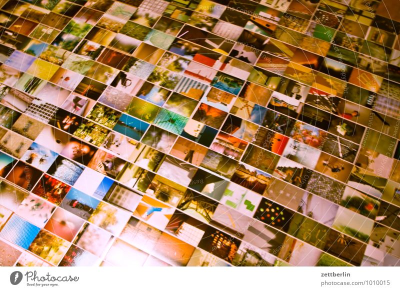 Photos on the floor album Detail Section of image Selection Image Photography Art gallery Crowd of people Many Lie Editorial Office Museum Colour Multicoloured