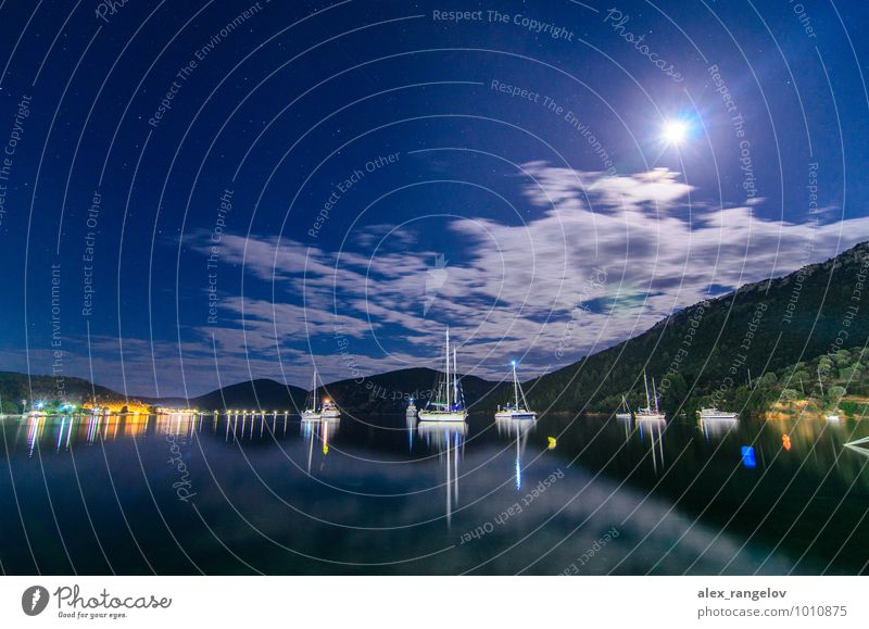Moon over Porto Cufo bay Landscape Water Sky Night sky Stars Full  moon Summer Coast Bay Harbour Yacht harbour Beautiful Blue Romance Relaxation Serene Climate