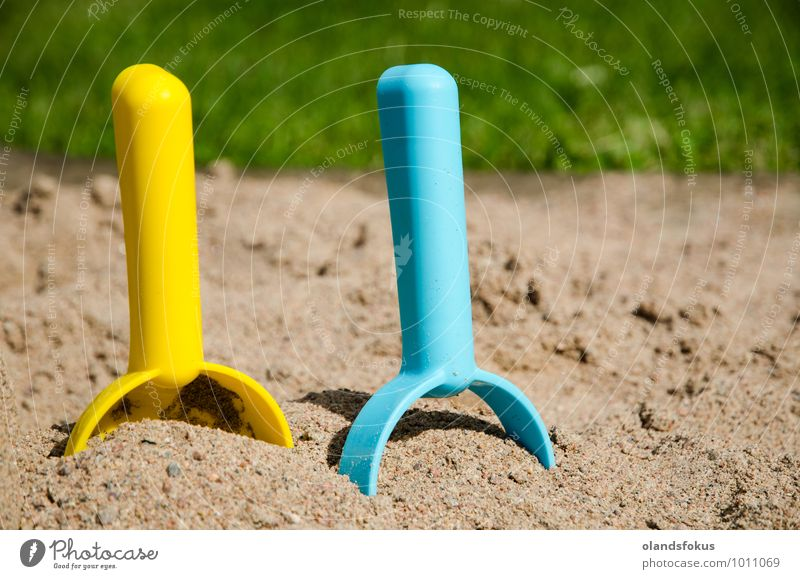 Sandbox level concept Joy Leisure and hobbies Playing Summer Tool Grass Toys Plastic Blue Yellow Green Colour background colorful Conceptual design conceptual