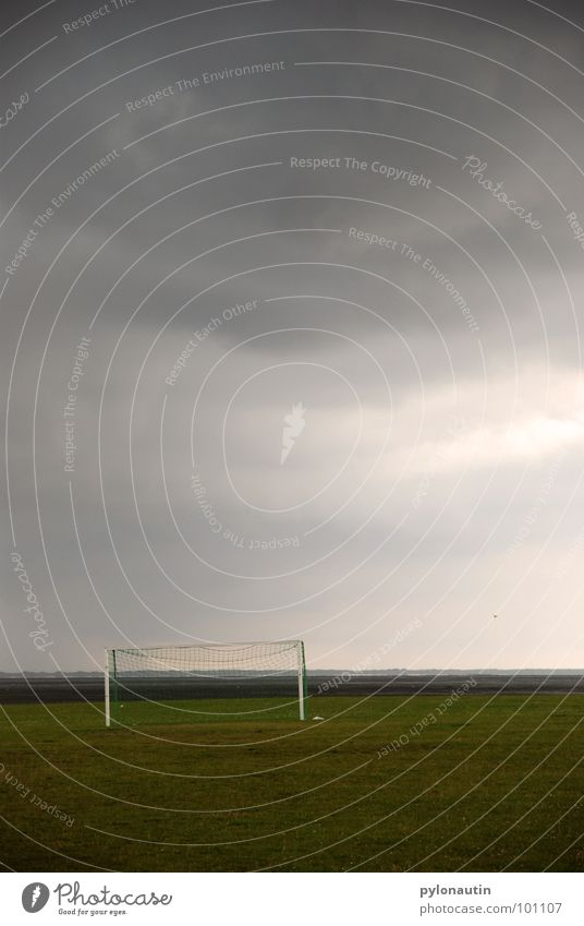 T(h)or before the storm Clouds Green Gray White Meadow Playing Sports Soccer Gate Sky Thunder and lightning Rain Lawn