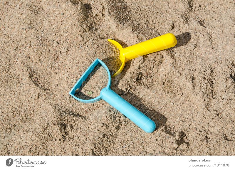 Sandbox with plastic toys Joy Leisure and hobbies Playing Summer Tool Toys Plastic Blue Yellow Colour background colorful Conceptual design conceptual level