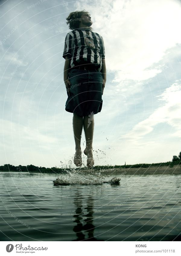 Sky Man Water Beach Joy Clouds Playing Jump Waves Flying Tall Drops of water Young man Upward Dynamics Surface of water