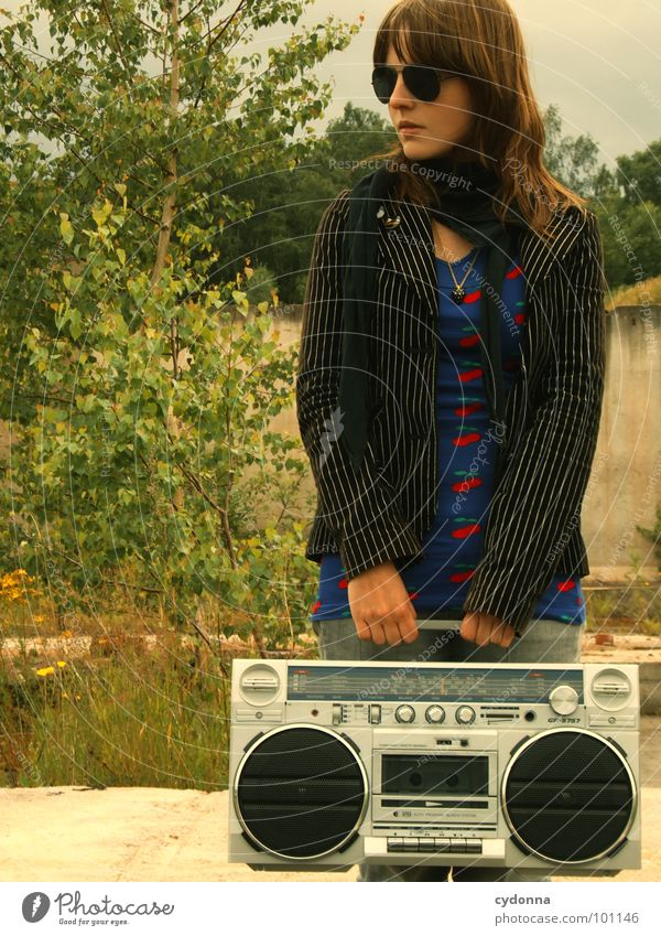 Woman Human being Nature Loneliness Style Music Landscape Concrete Cool (slang) Stand To hold on Derelict Jacket Radio (broadcasting) Sunglasses Ghetto blaster