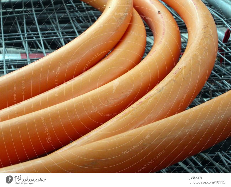 Bockwurst XXL Construction site Craft (trade) Fat Effluent Hose Statue Pipe Orange conduit reeds Abstract Small sausage Colour photo