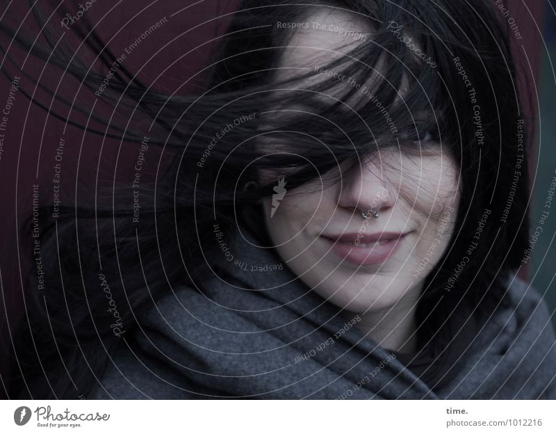 . Feminine Young woman Youth (Young adults) 1 Human being Wall (barrier) Wall (building) Coat Piercing Black-haired Long-haired Observe Smiling Looking Wait