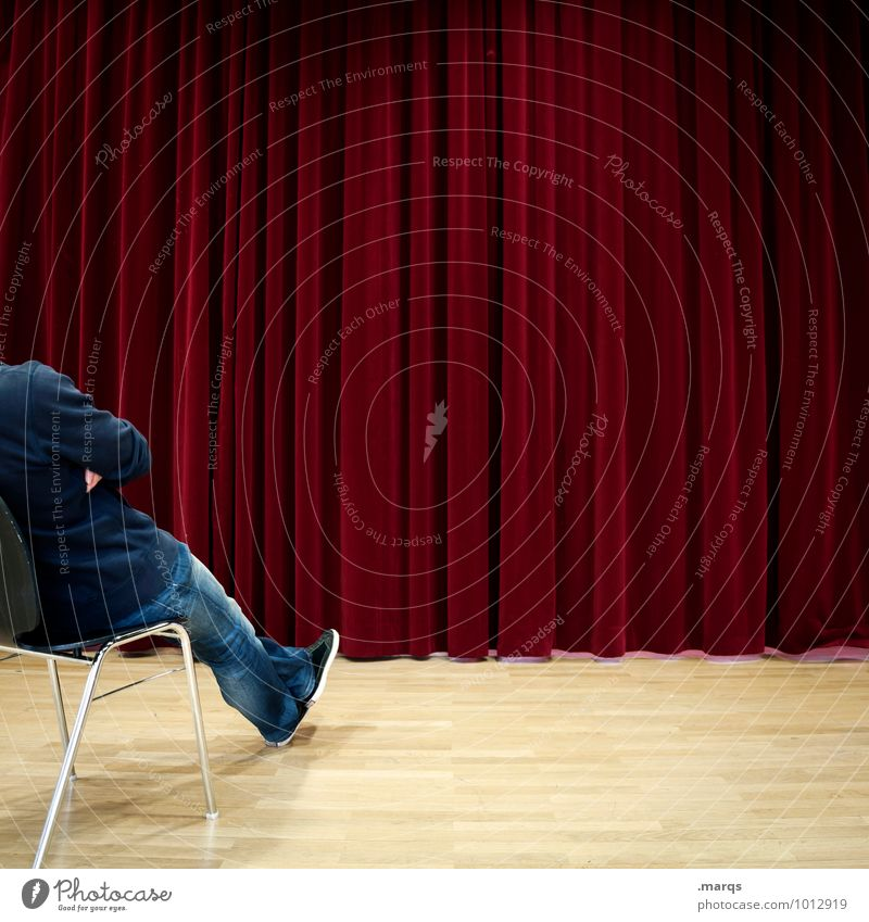 expectations Event Human being Masculine 1 Shows Cinema Drape Sit Wait Red Anticipation Curiosity Interest Expectation Future Colour photo Interior shot Pattern