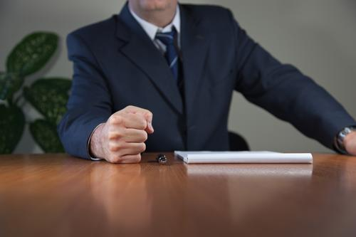 Businessman has put his fist on the table Table Office Meeting Human being Masculine Man Adults Hand 1 45 - 60 years Shirt Suit Tie Paper Pen Determination