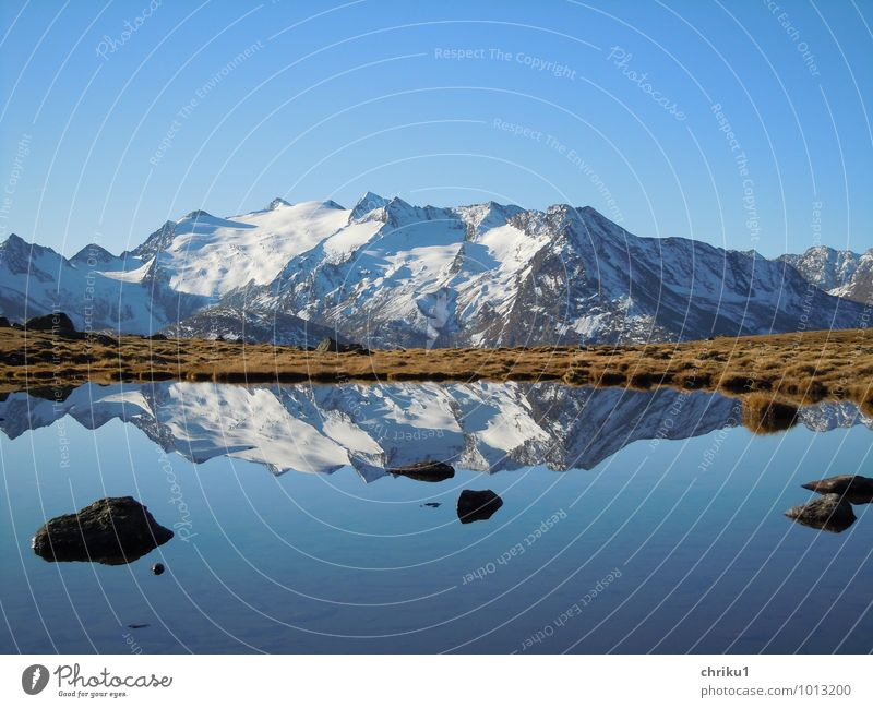 double chain Nature Landscape Water Sky Autumn Alps Mountain Snowcapped peak Lake Freedom Calm Colour photo Exterior shot Deserted Morning Reflection