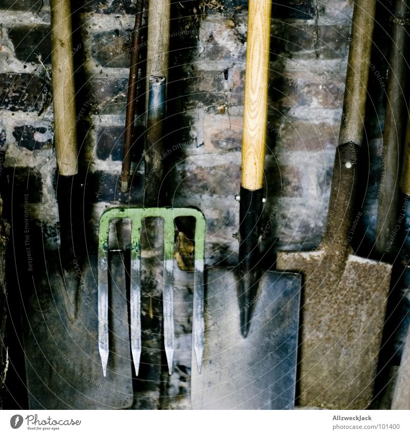 tool sheds Spade Shovel Dig Working in the fields Gardening Pitchfork Brick Wall (barrier) Wall (building) Small room Tool Work and employment Craft (trade)