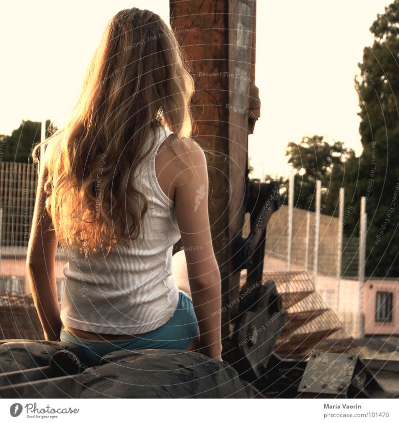 Woman Loneliness Hair and hairstyles Wait Working man Sit Construction site Craft (trade) Tire Long-haired Construction worker Dreamily Flirt Excavator Rubber