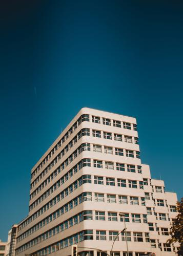 Shell House Sightseeing Bauhaus Cloudless sky Office building Facade Tourist Attraction Undulation Elegant Retro Blue Innovative Symmetry Past