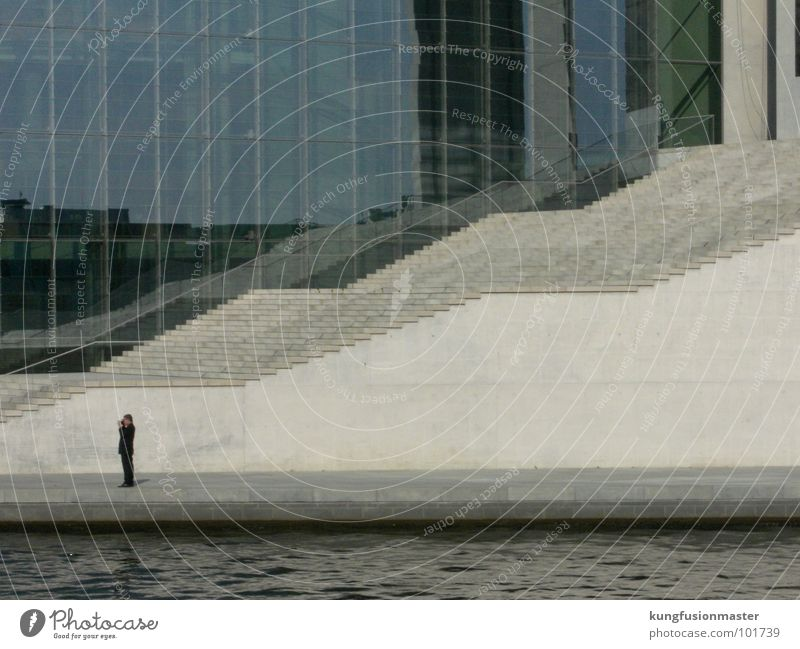 man with stairs Photographer Suit Wall (barrier) Concentrate Landmark Monument Stairs Reichstag River