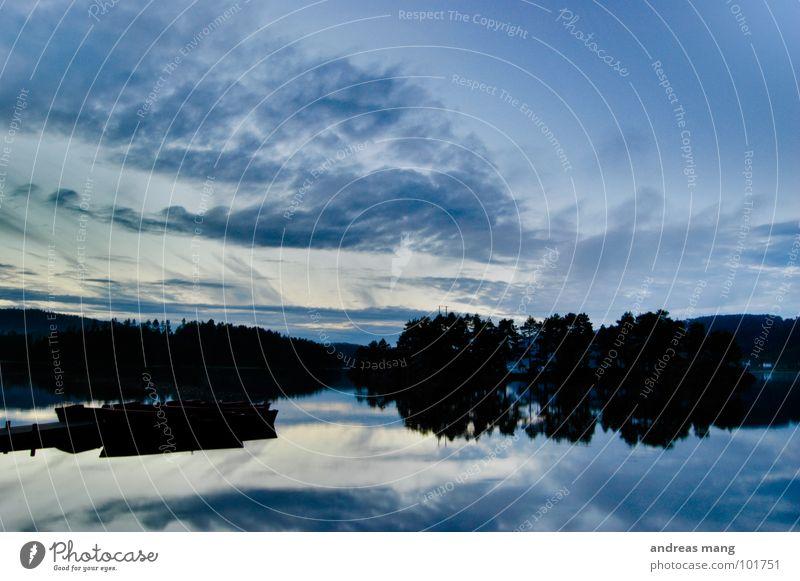 Water Sky Tree Blue Calm Clouds Dark Lake Watercraft Moody Coast Island Leisure and hobbies Mirror Footbridge Dusk